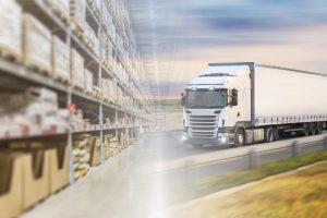 Warehouse Racking Cartons Distribution Freight Truck Driving Green Grass Gard Rail